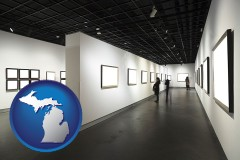 michigan map icon and people viewing paintings in an art museum